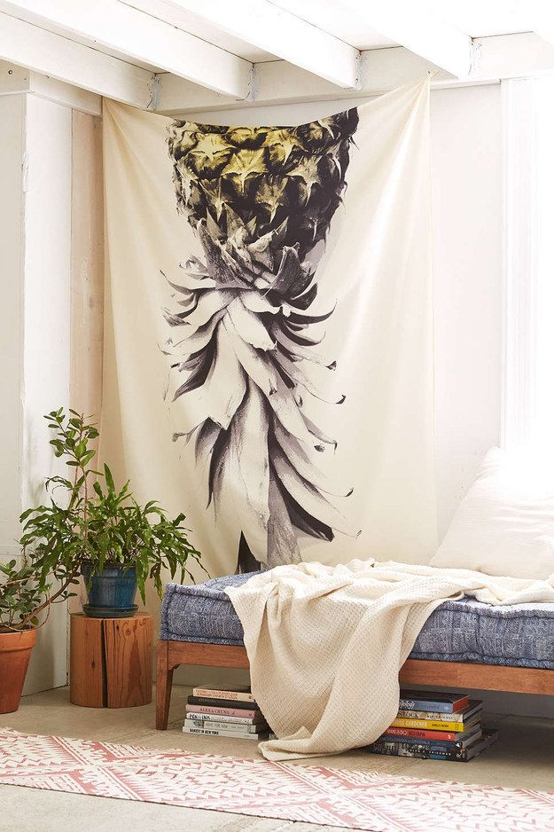 A hanging pineapple tapestry.
