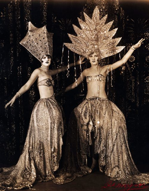 how did these burlesque dancers even move wearing these huge, elaborate, sparkly headdress concoctions?