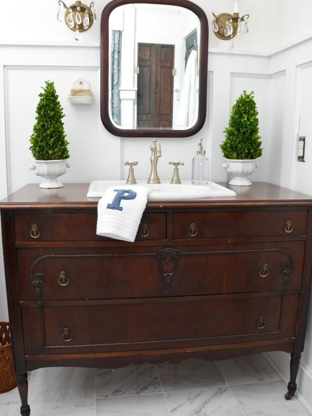 Turn a vintage dresser or buffet into a bathroom vanity with these step-by-step instructions at HGTV.com.