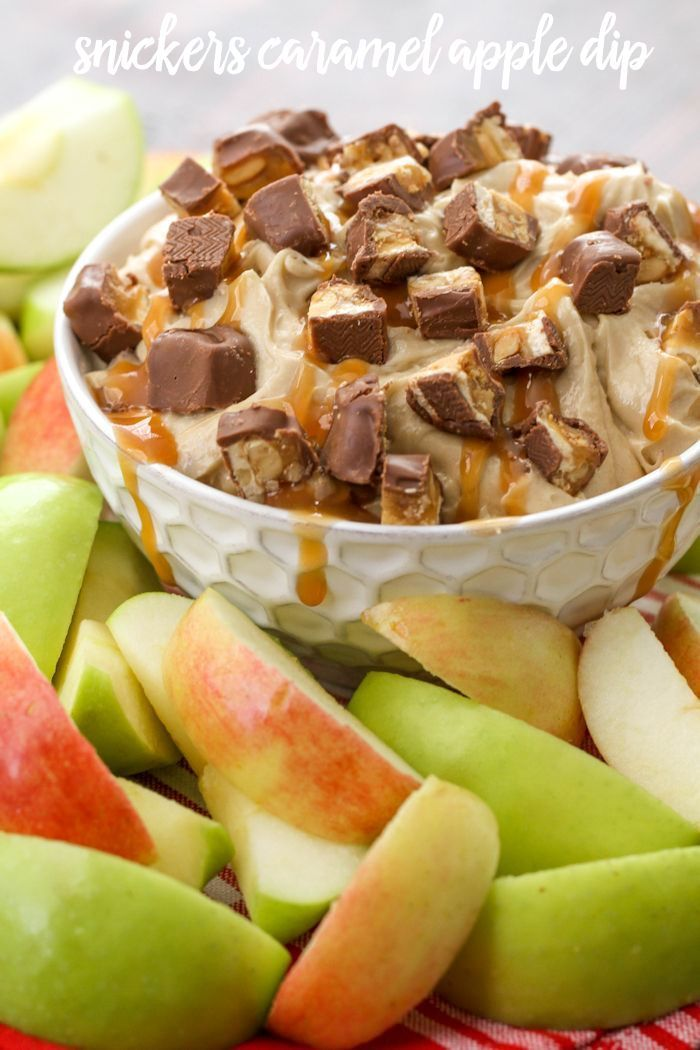 Snickers Caramel Apple Dip - it takes minutes to make and is a hit at every party or function. Get the simple recipe on { lilluna.com } Made with cream cheese, brown sugar, sugar, vanilla, and caramel sauce!