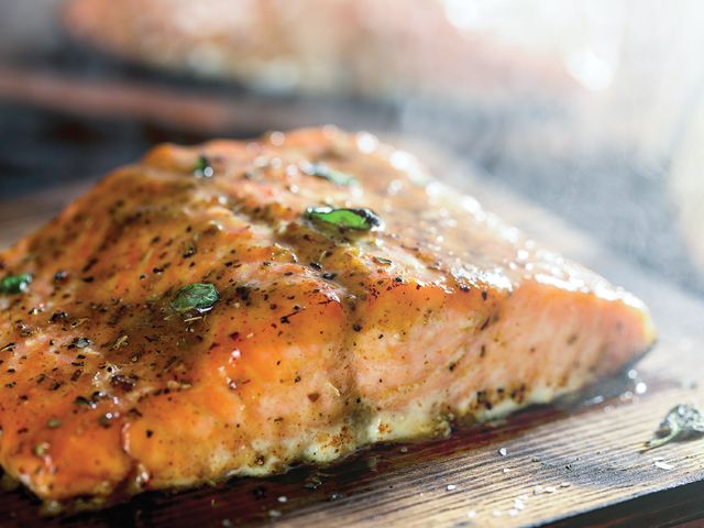 Cedar-plank-grilled salmon with lime dressing. Take your salmon up a notch by basting it in a zesty sauce and grilling over a cedar plank.