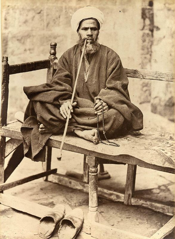 Man Smoking a pipe in Egypt c. 1880