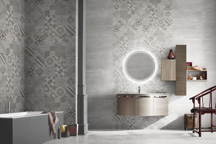 Baño estilo vintage con decor hidráulico color gris.