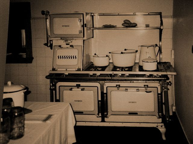Antique stove and 1920's kitchen  Antique stove (New Princess) in a restored home, part of the Western Reserve Historical Society in Cleveland, Ohio.