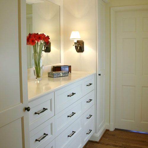 Wonderful built-in dresser with mirror and sconces and tall cabinets can customize your dressing area