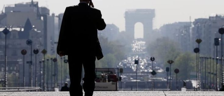 A businessman walks on the esplanade of La Defense, in the financial and business district in La Defense, west of Paris, April 10, 2014.   REUTERS/Gonzalo Fuentes (FRANCE - Tags: BUSINESS)