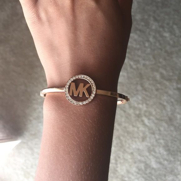 Authentic Michael Kors Bracelet Rose gold, latches on the side! In perfect condition, only been worn a handful of times Michael Kors Accessories