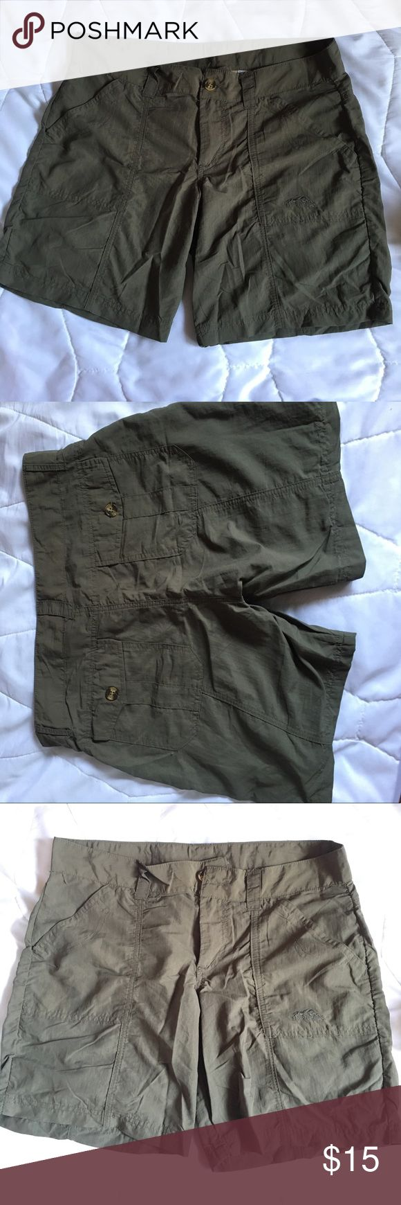 Women's Cargo shorts Olive green colored shorts for working in the garden. Worn a couple times for volunteer work in another country. Super comfy. Size small but would fit a medium better. American Outback Shorts Cargos