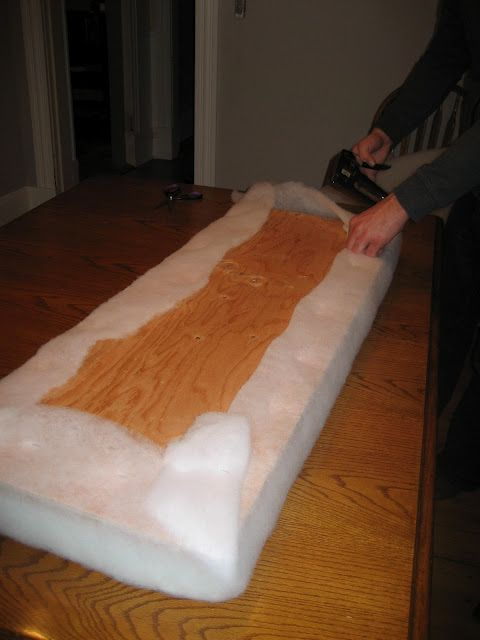 DIY Cushion for bench seat~Attach the foam to a piece of  plywood using spray adhesive. Then, wrap the plywood and foam with cotton batting and staple on the fabric.