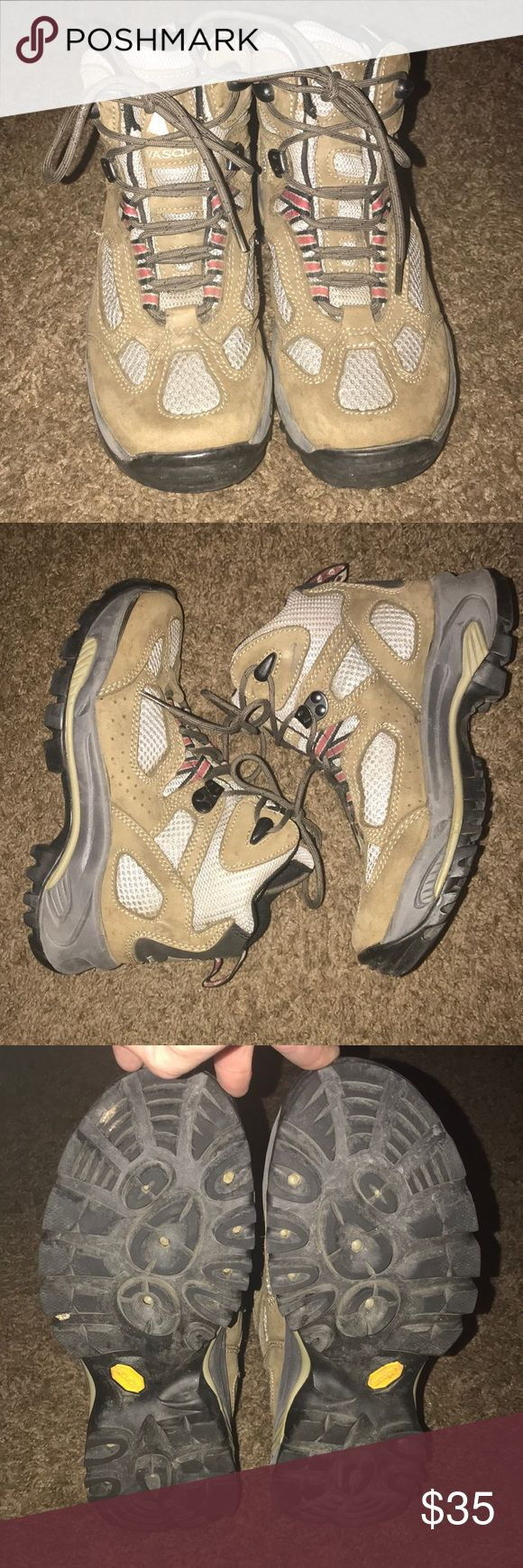 Vasque hiking boots! Vasque hiking boots in khaki and grey. Genuine leather and vibram soles ! I wore these on one hiking trip and they were amazing i never slipped and great support!!I just never hike anymore so they just sit in my closet. Vasque Shoes Winter & Rain Boots