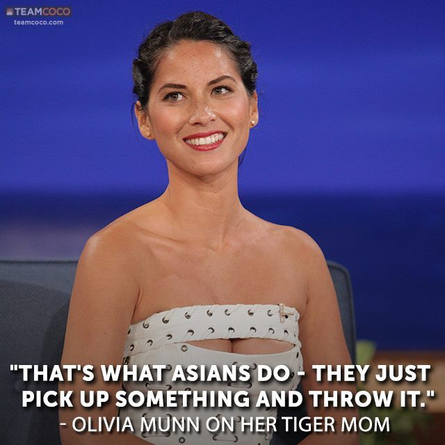 """Olivia Munn recalls nightly beatings from her Tiger Mom; on """"Conan"""" (TBS © 7/19/2013)."""