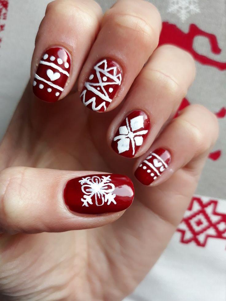 Winter red nails. Norwegian pattern.