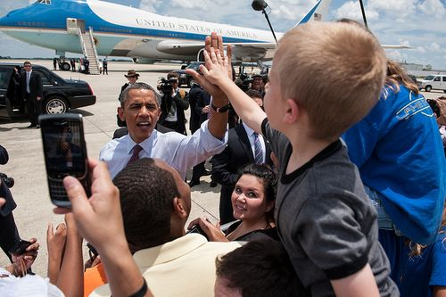 POTUS and high-fiving children.