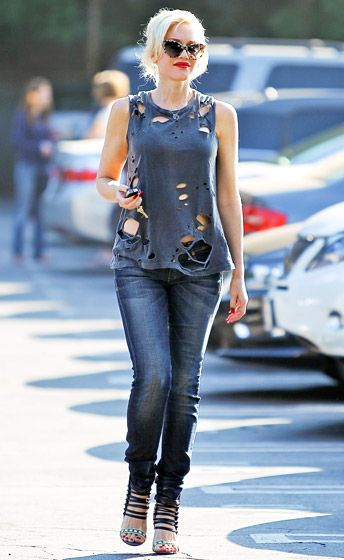 Gwen Stefani — pregnant but not quite showing — sported a fashionably torn tank top in L.A.