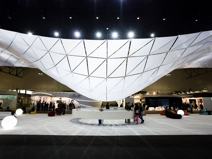 Triangular panels of satin polycarbonate created a lightweight 'organic cloud' #eventdesign #spatial #eventprofs