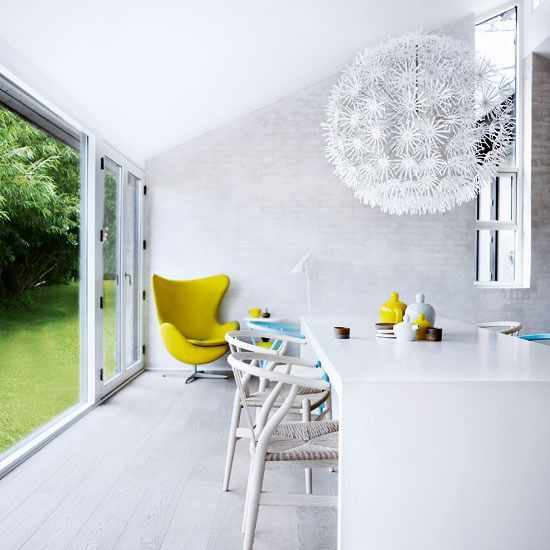Lemon yellow accents in modern white dining room