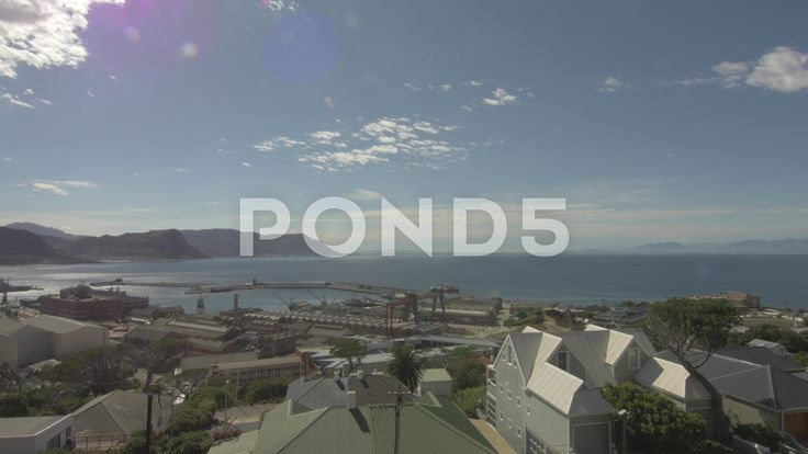 4k Beautiful Blue Water Ocean View Lens Flare Mountains Pier Dockyard - Stock Footage | by RyanJonesFilms