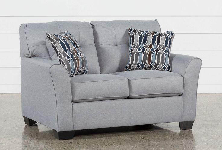 Create a comfortable, contemporary living room for less with our handsome Chilkoot Smoke full sofa sleeper. Available in 2 cool neutrals, this design is elevated by flare arms, tufted back cushions and reversible accent pillows that keep things simple and solid on one side, and sophisticated and geometric on the other. Thanks to a full-size memory foam mattress, you can host overnight guests anytime.