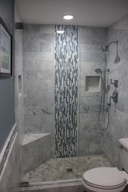Good example of a recessed product niche in tile, which keeps the shower  neat and