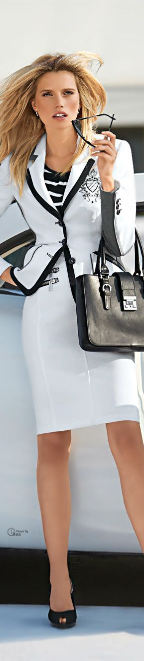 Pretty added elements, monograms, zippered pockets, and black banding...beautiful contrast of black and white!