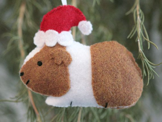 This guinea pig ornament is completely hand stitched and embroidered. Each…