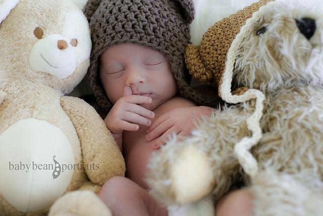 baby + stuffed animals. adorable.