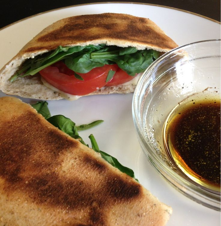 Caprese Pitas. Laughing cow cheese, spinach, roma tomatoes, and a dipping sauce of oil and balsamic. All around 200 calories! YUM!