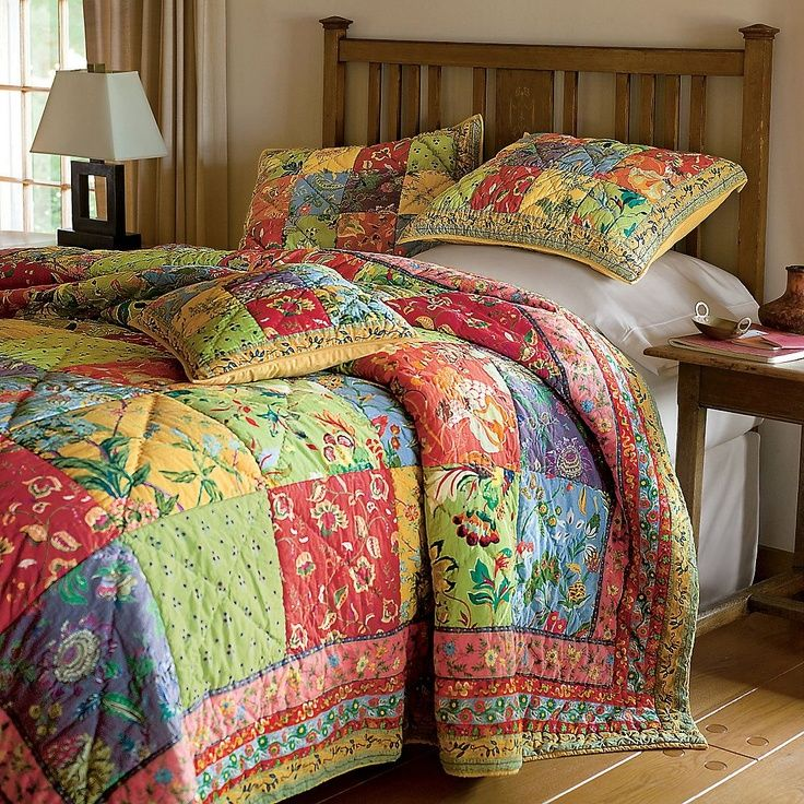 Simple to make:  Big squares of pretty prints and easy border fabrics.  And the result is still stunning!  Note the pillows and shams use the same idea, just scaled down in size.