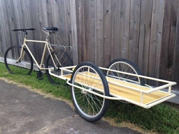 Rear view of a custom bike trailer I welded from scratch out of lightweight tubing and fitted polished wood.  Summer 2015