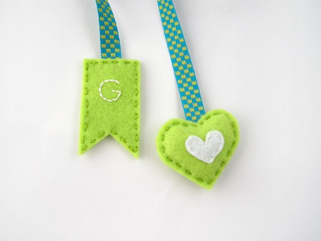 A personalized bookmark, with a mini green heart and embroidered initial on a blue and green ribbon. A perfect gift for a book lover and a great way to mark your pages as you read your favorite...