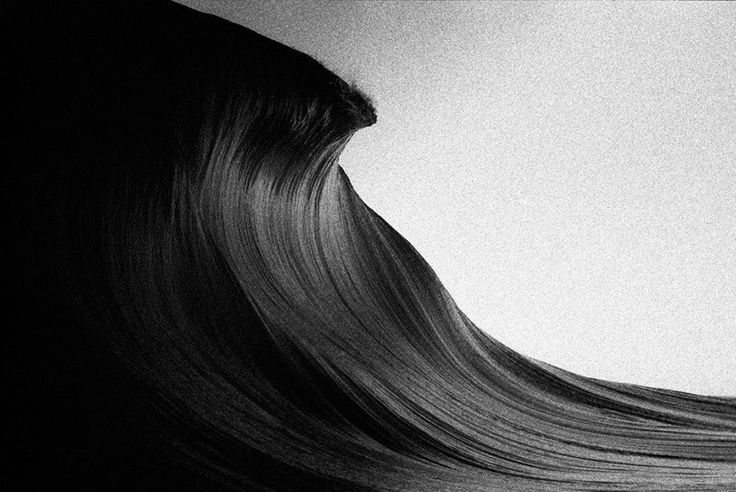 Beautiful grainy (film) black & white photo of a perfect wave by surf photographer Trent Mitchell