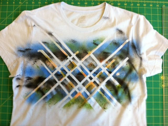 transform a shirt using tape and fabric spray paint!