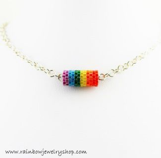 Beaded pendant hangs on a 20 inch chain, but can be adjusted to suit.