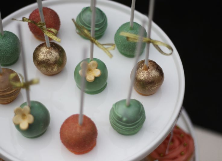 Peach, mint and gold Tim Tam cake pops.