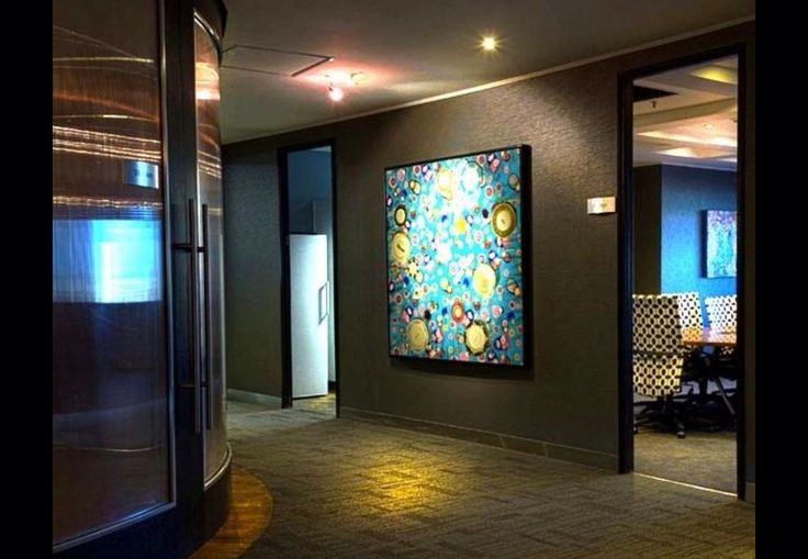 Tip: Over 90% of employees believe that featuring art prominently in the workplace boosts overall productivity.   Artwork in workspace by Platynum Interiors