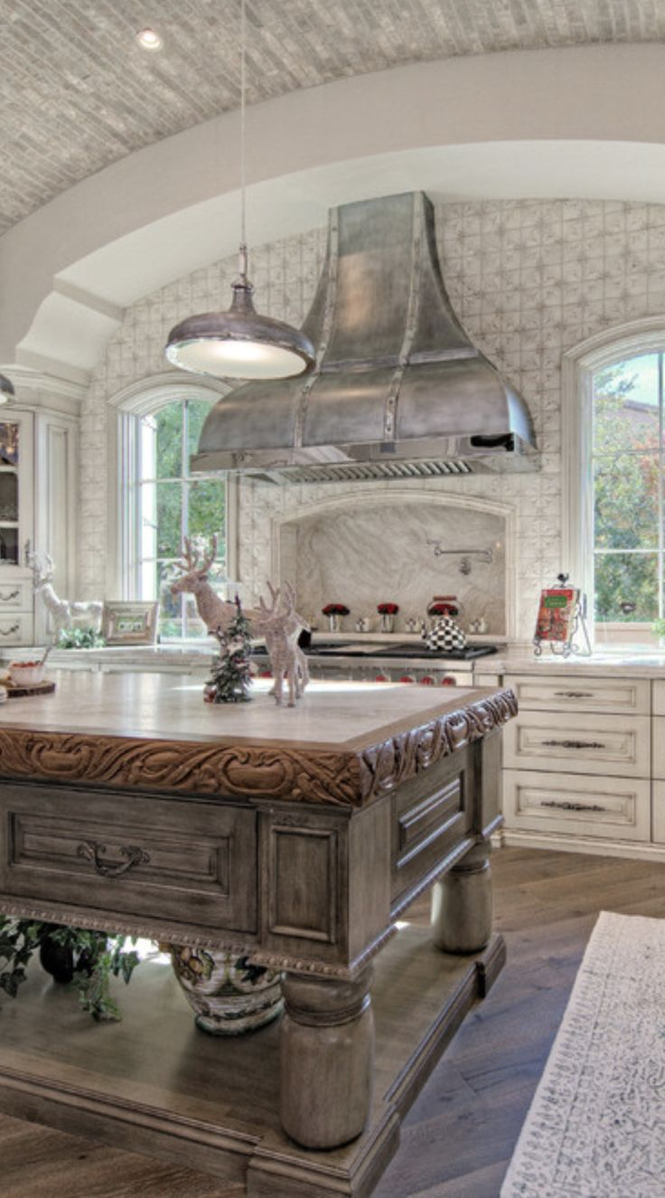 old world kitchen with their large cooking hearths or grottos and distressed unfitted cabinets. Interior Design Ideas. Home Design Ideas