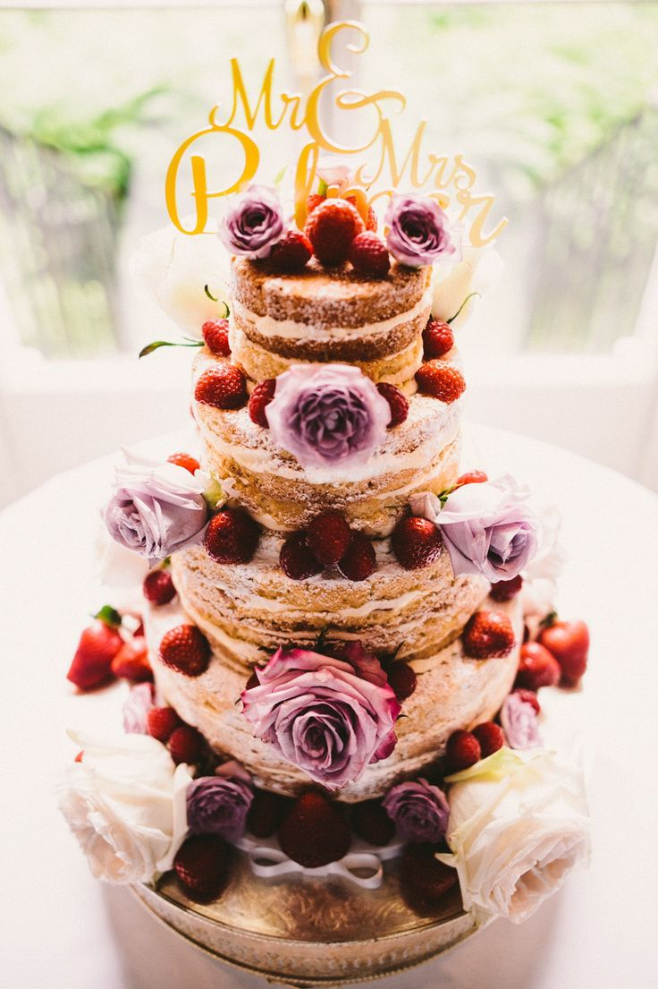 Naked victoria sponge cake decorated with flowers and strawberries | Photography by http://barneywalters.com/
