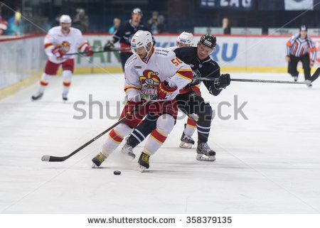 ZAGREB, CROATIA - JANUARY 04 2016 : Kontinental Hockey League - KHL MEDVESCAK VS JOKERIT HELSINKI in Zagreb, Croatia. Andreas Jamtin (27) and Juhamatti Aaltonen (50).