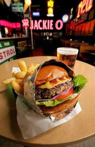 Fat Bob's- The Jackie O burger, wrapped in chip basket with a beer from Fat Bob's on Coch