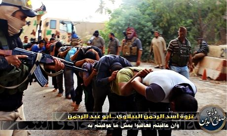 Isis militants with Iraqi army prisoners in the set of shocking photographs showing mass executions. Photograph: Welayat Salahadden