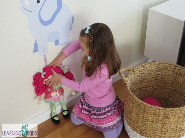 Measurement activity for kids using a height chart and stuffed toys