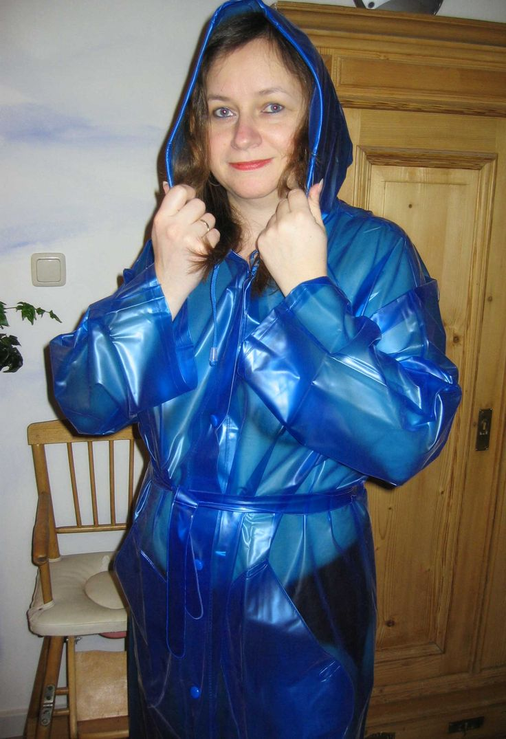 Amateurmodel Wearing A Transparent Blue Pvc Raincoat