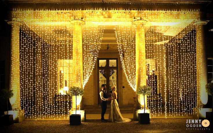 Lights outside the grand entrance with the bride and groom