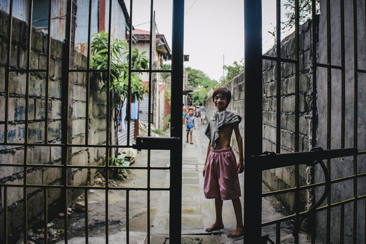 I saw this boy about to make his way home through these iron bars. Noticing the different elements coming together, I quickly signalled to the boy if I could take a photo of him, I quickly positioned myself between the bars and took the shot. Hoping to emphasise the bars surrounding this small boy.