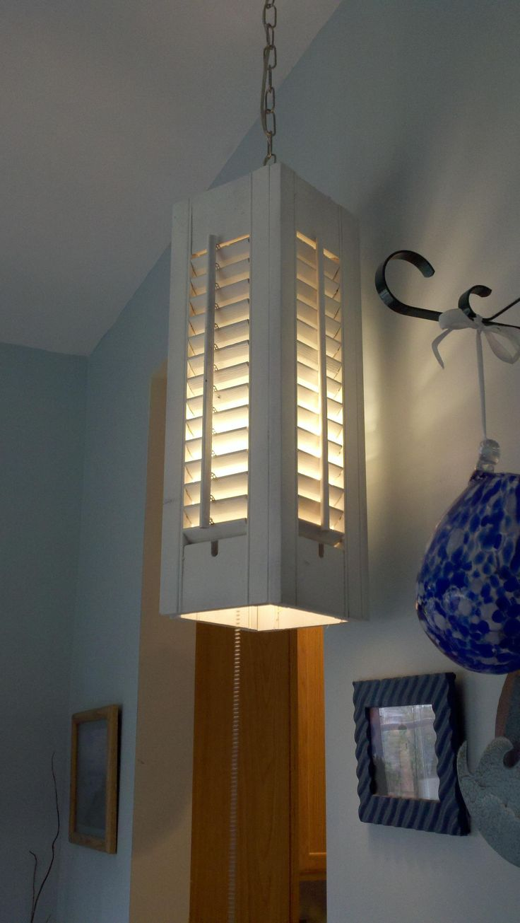 maybe arounf the telephone pole artfully.10 Things to Make with Old Plantation Shutters: A pendant lantern