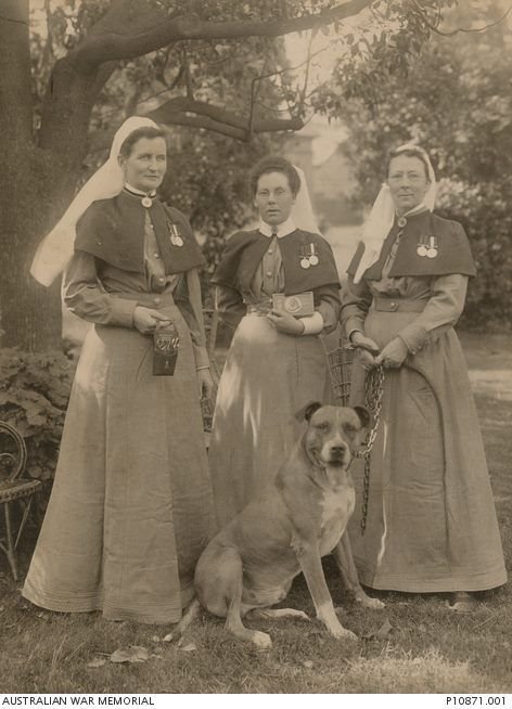 Three nurses who accompanied the Second Contingent to the Boer War as members of the NSW Army Medical Corps.  Matron E J (Nellie) Gould, Lady Superintendent of the first contingent of Australian military nurses to serve overseas, holds a nurse's chatelaine containing essential tools of the trade (left).  Miss Penelope Frater (Sister), holding her Queen Victoria chocolate box, one of those issued to troops and nurses to celebrate the New Year of 1900 (centre).  Miss Julia Bligh Johnston…