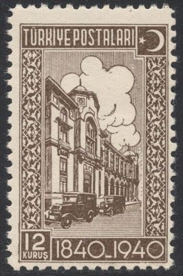The final stamp in the set, the 12 kurus bistre-brown, shows the General Post Office in Istanbul. From Stamp Magazine Blog.
