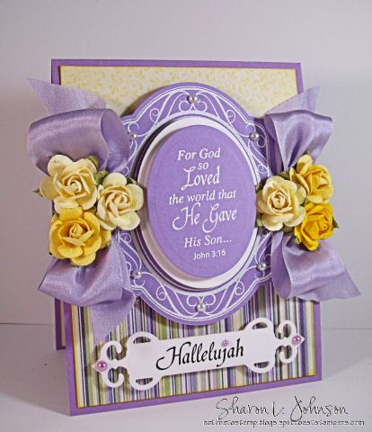 For God so Loved the World...John 3:16.  Made with products by JustRite, Spellbinders, May Arts, and Prima, all available at The Stamp Simply Ribbon Store.