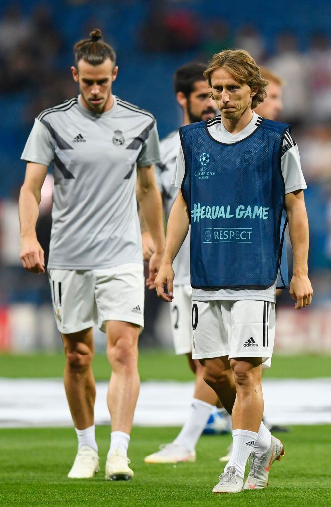 75a20bc9b Real Madrid s Croatian midfielder Luka Modric (R) and Real Madrid s Welsh  forward Gareth Bale warm up before the UEFA Champions League group G  football ...