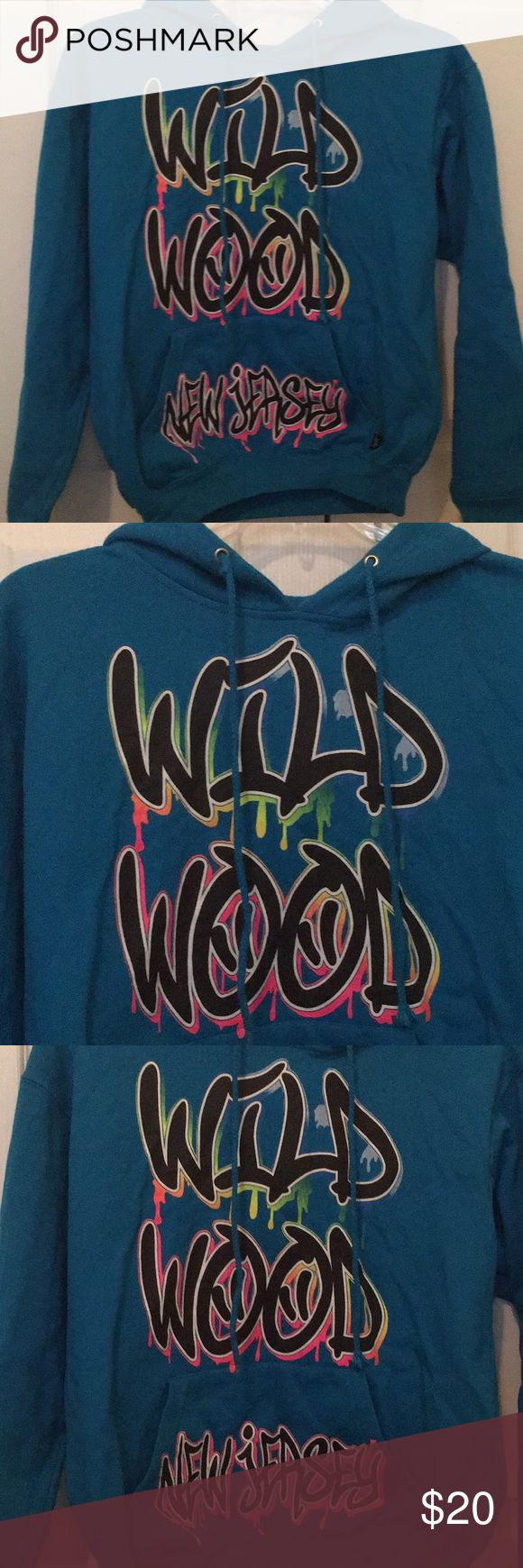 A blue and multi color Wild Wood hoodie This Wild Wood hoodie is multi coloured and is warm and perfect for a chilly day. Great for all ages Tops Sweatshirts & Hoodies